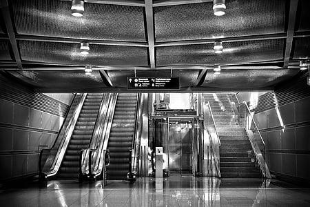 grayscale photo of empty escalator