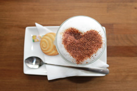 coffee and biscuit on white ceramic plate