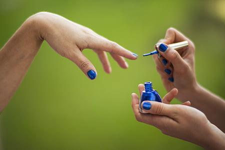 person doing nail polish during daytime