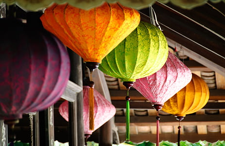 close-up photo of paper lanterns hanged on ceiling