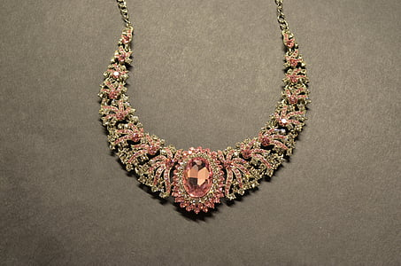 women's silver-colored necklace with pink gemstones