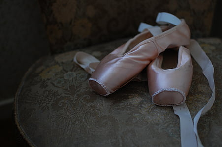 pair of pink pointe shoes