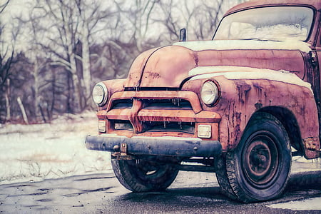 red vehicle on gray concrete pavement