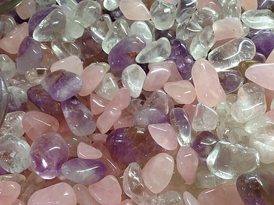 closeup photo of pink, clear, and purple beads