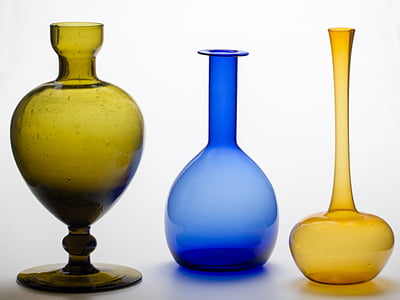 yellow, blue, and green glass vases