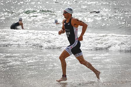 man run near seashore during daytime