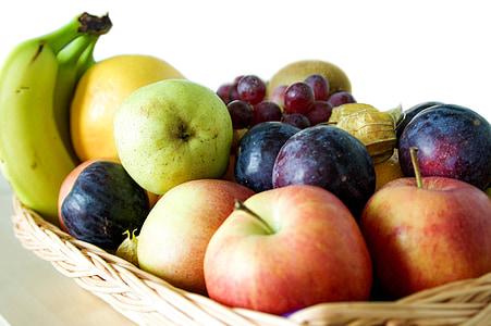 assorted fruits on beige wicker basket