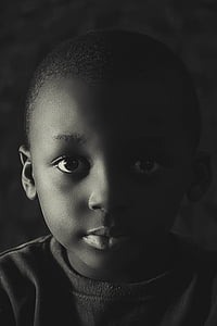 grayscale portrait photography of child