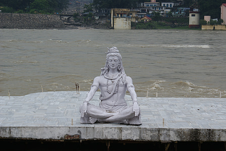 male statue near body of water