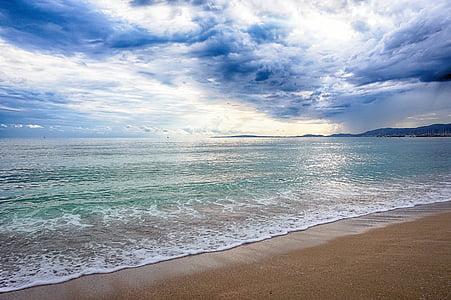 landscape photography of seashore under cumulus clouds