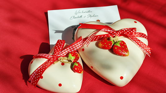two white-and-red hearts strawberries gifts