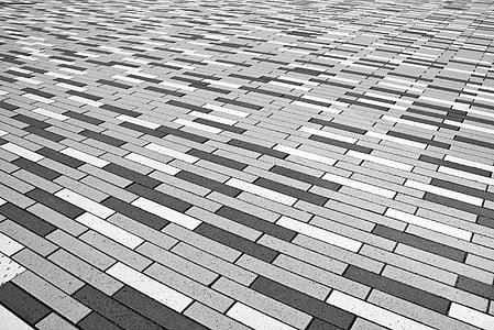 rectangular gray, white, and black floor tile lot