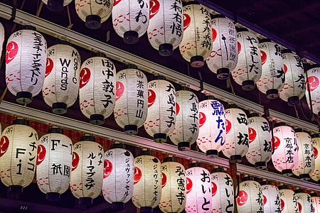 lighted and hanged Japanese paper lanterns