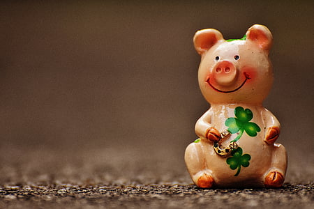 pink ceramic pig figurine smiling