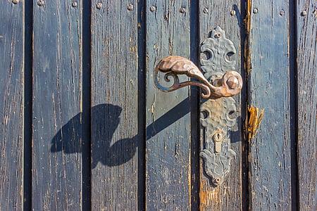 brown metal door lever