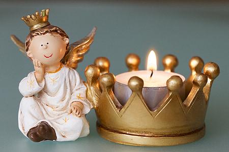 white dressed angel and crown figurine