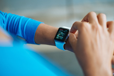 person using silver Apple Watch