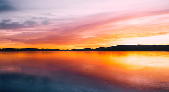 body of water during dawn