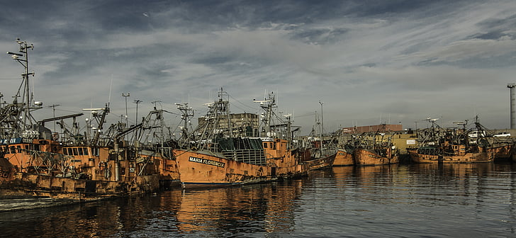 orange ship on ocean