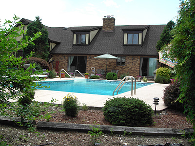 brown house with swimming pool