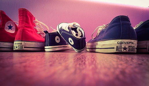 close-up photo of three assorted-color Converse All-Star shoes