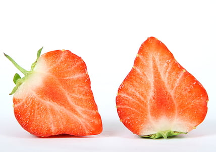 two sliced strawberries