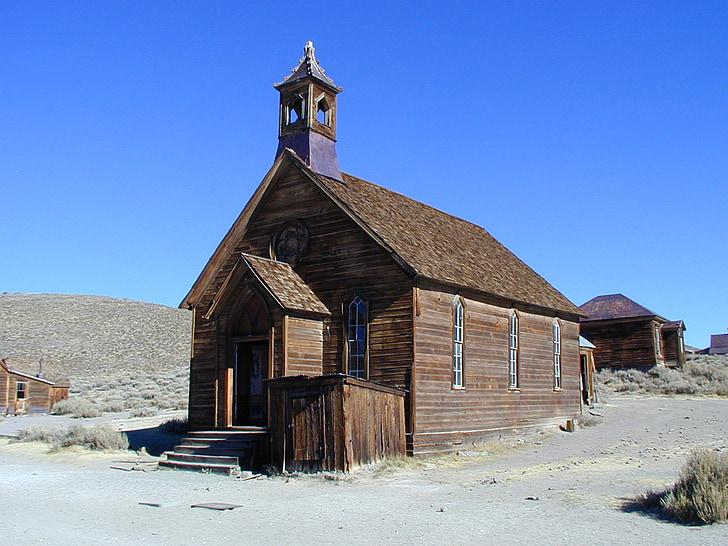 brown chapel near house