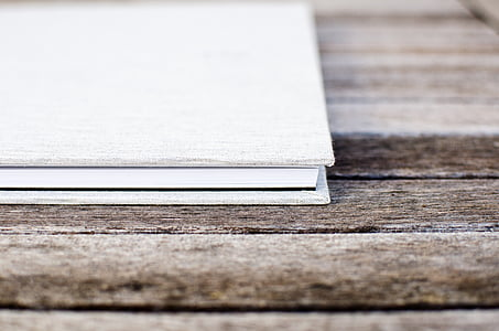 white notebook on table