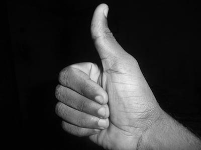 grayscale photo of okay hand gesture