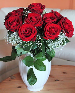 red rose arrangement on white vase