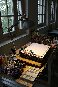 closeup photo of sketch table set with lamp