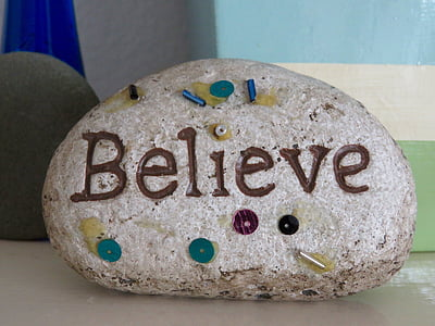 stone with believe carving and paint