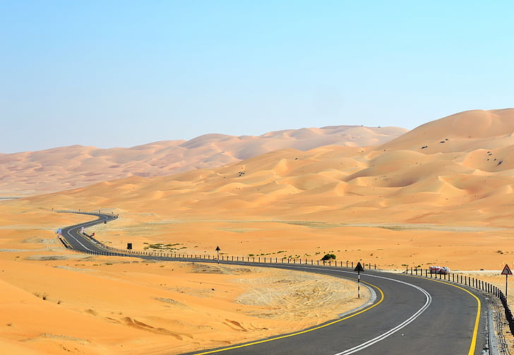 empty curved road in the middle of desert