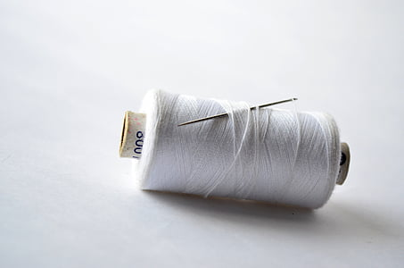 white thread on white surface