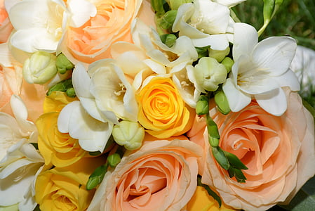 photo of peach-colored roses and white petaled flowers