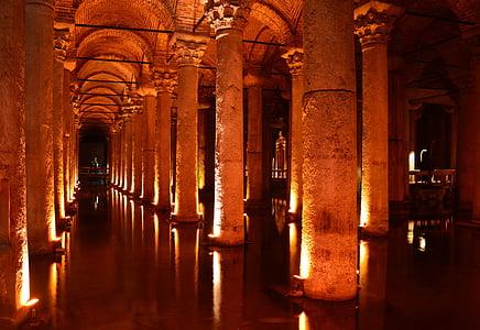 lighted concrete building pillar