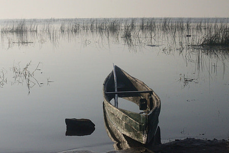 gray boat on lake