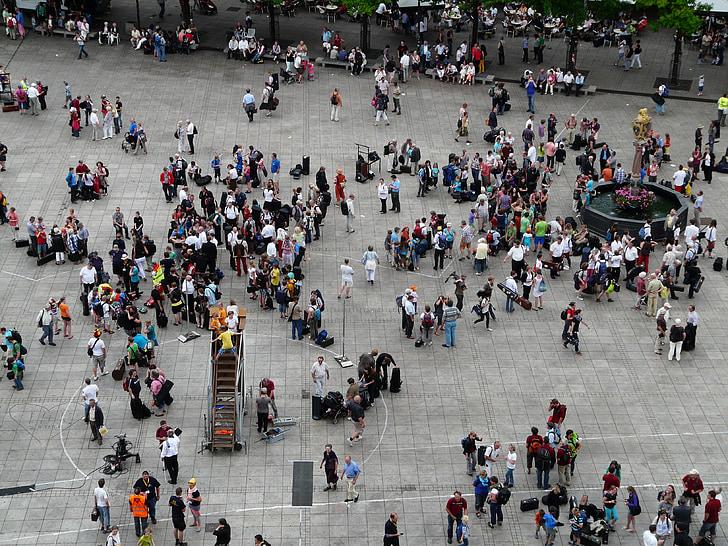 people walking on gray floor park