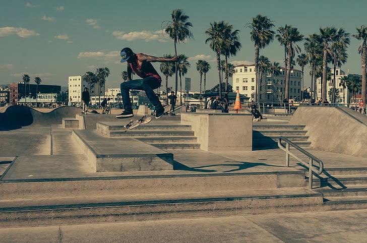 man skateboarding on skateboard field during golden hour
