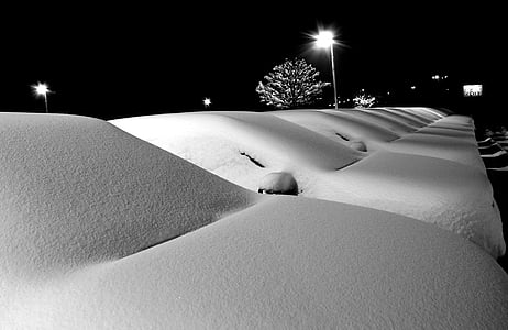 grayscale photo of road covered by snow