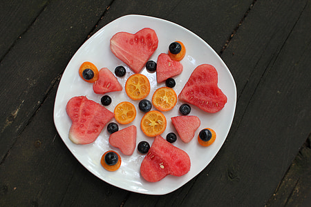 sliced watermelon and orange fruits with olives