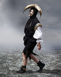 person wearing black, white, and gold jester suit