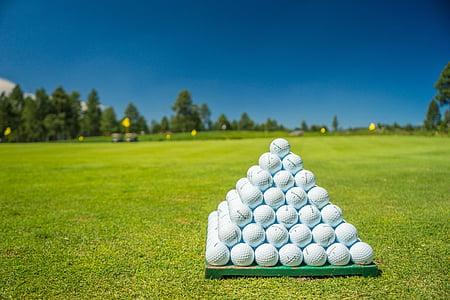 white golf balls on green fieled