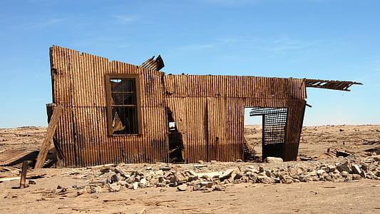 brown wooden house frame photo taken during daytime