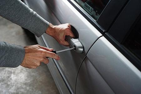 person unlocking car door handle