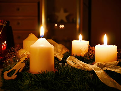 three white lighted candles