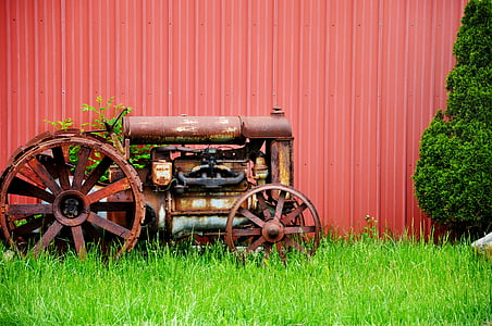 brown tractor on green grass