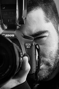 grayscale photo of a man using Canon EOS 6D