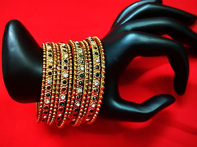 gold-colored bangles with assorted-color gemstones
