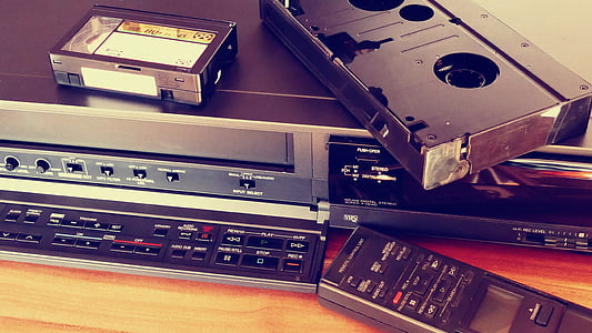 black VHS player with VHS tape